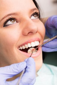 smiling woman during dental exam