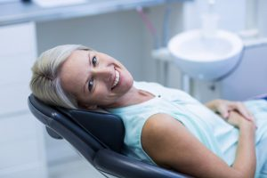 Happy woman in the dental chair.