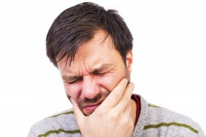 Man experiencing dental pain.