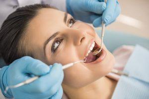 Woman having dental examination.