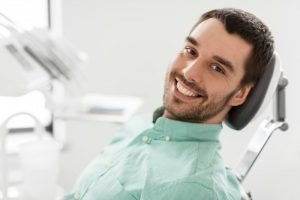 Smiling man in the dental chair.